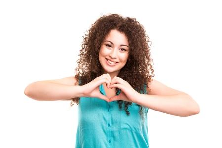 흰색 배경 위에 절연 그녀의 손으로 심장 모양 만들기 아름 다운 여자, 스톡 콘텐츠