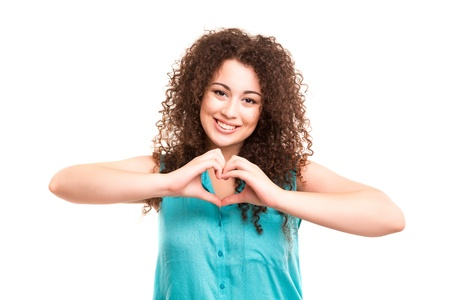 Beautiful woman making a heart shape with her hands, isolated over white background Stock Photo