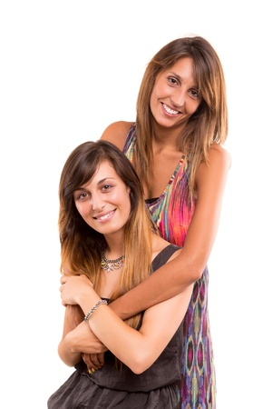 Young women posing isolated over a white background