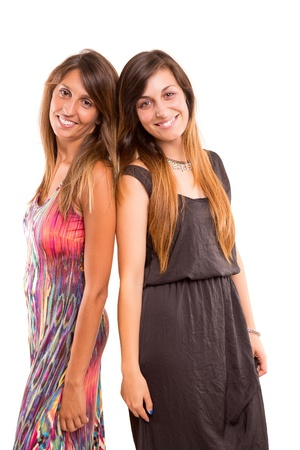 Young women posing isolated over a white background photo