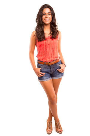 latina teen: Young and beautiful student posing isolated over white