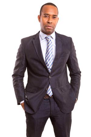 ポーズを白で隔離された若いハンサムなアフリカ ビジネス男 写真素材