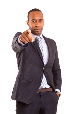 African business man poiting at you, isolated over white
