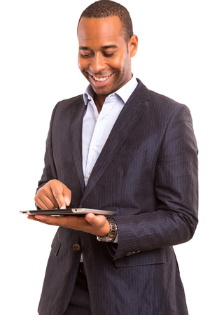 A young african business man working with a laptop photo