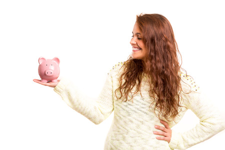 Young woman presenting a piggy bank (money box) - savings concept photo