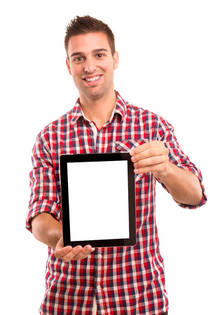 Happy young man presenting your product in a tablet computer photo