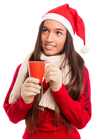 Beautiful asian woman with santa claus hat holding a cup of tea photo