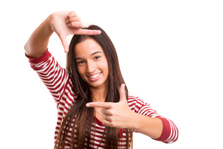 Young asian woman making framing key gesture - isolated over white photo