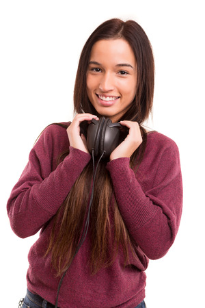 Young and beautiful asian woman listening to music photo