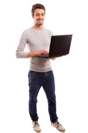 Young handsome man working with laptop computer photo