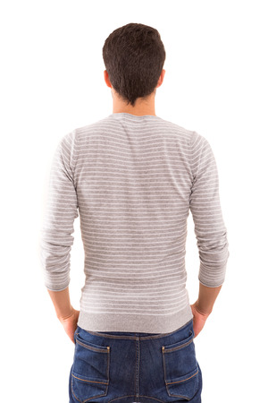 guy standing: Young man with back turned to camera Stock Photo