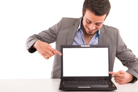 Young man presenting your product in a laptop computer photo