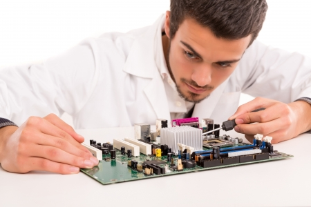 A computer engineer or technician, working on a computer motherboard Stock Photo