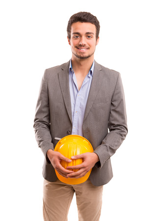 Handsome young engineer posing isolated over white background photo
