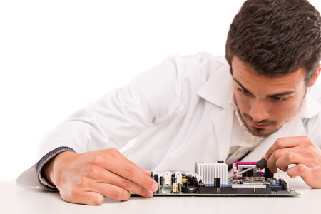 A computer engineer or technician, working on a computer motherboard photo
