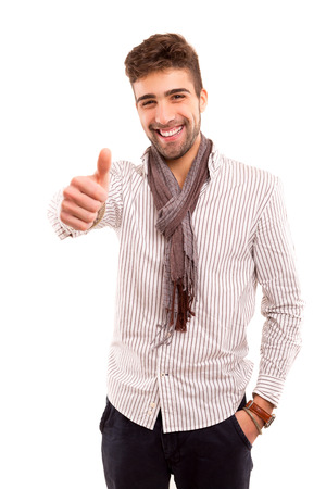 Handsome young man signaling ok, isolated over a white background photo