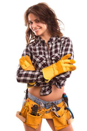 mujer trabajadora: Sexy mujer joven trabajador de la construcción