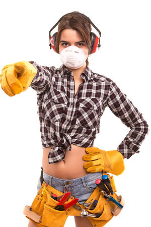 Sexy young woman construction worker pointing at you photo