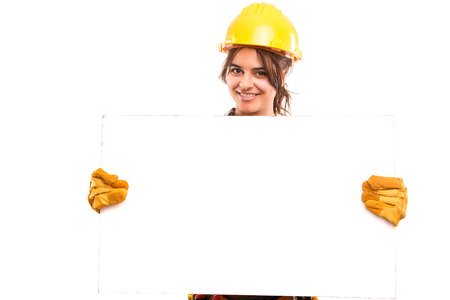 industrial safety: Sexy young woman construction worker, holding a white board