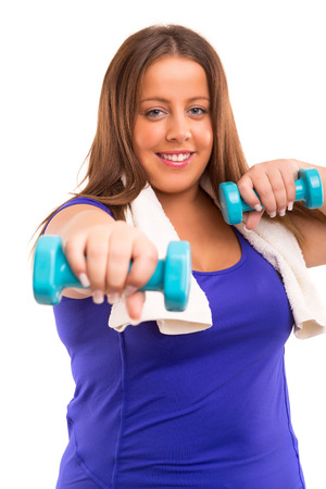 Beautiful large woman exercising - isolated over a white  photo
