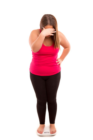 Fat woman very worried with her weight