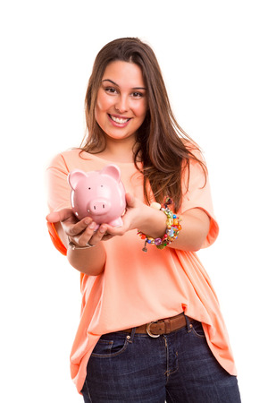 Young woman presenting a piggy bank (money box) - savings concept photo