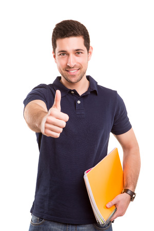 Young happy student posing isolated over white background photo