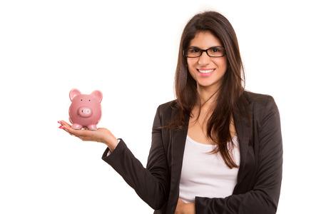 Young woman holding a piggy bank (money box) - savings concept photo