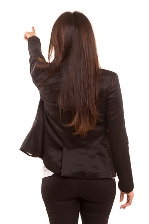 Businesswoman posing with her back faced to camera, isolated over copy space  photo