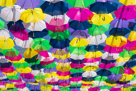 Lots of umbrellas coloring the sky in the city of Agueda, Portugal photo