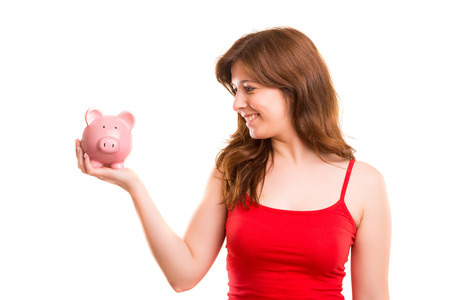 Young woman holding a piggy bank (money box) - savings concept photo