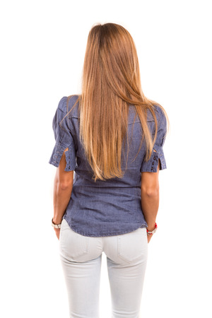 Businesswoman posing with her back faced to camera, isolated over copy space background photo