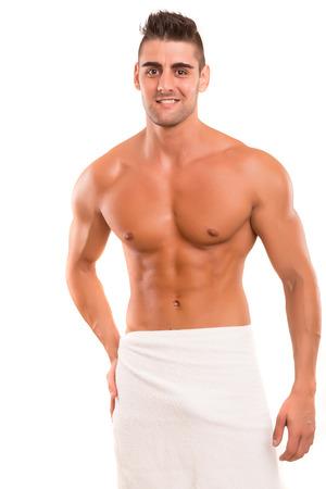 männer nackt: Stattlicher Mann, der in einer großen Form, isoliert in einer Kopie Raum Hintergrund Lizenzfreie Bilder