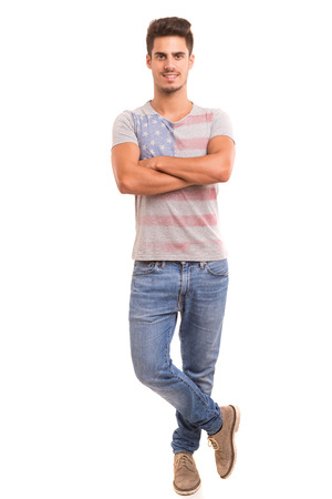 Studio picture of a young and handsome man posing isolated photo