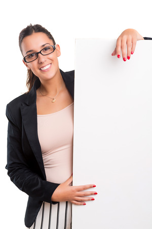 Young business woman presenting your product over a white card photo