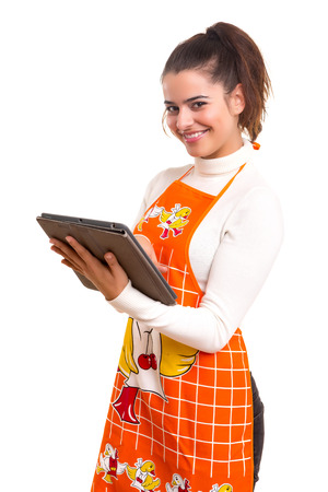 woman searching: Beautiful woman searching for a recipe over the internet