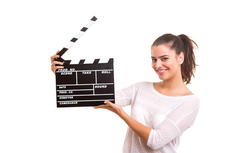 clapboard: Woman holding a clapboard isolated over white background