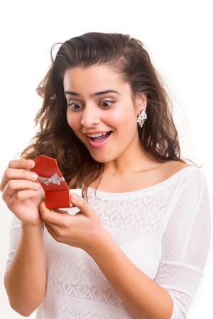 recieving: Beautiful young woman recieving wedding ring