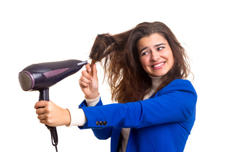 Young woman taking care of her hair isolated over white
