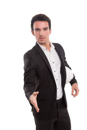 Young business man offering handshake, isolated over white photo