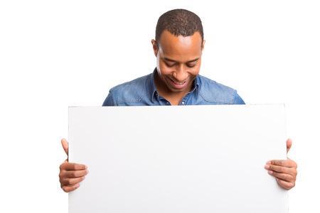 hombres negros: Hombre de negocios africano que presenta su producto