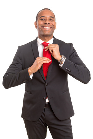 African business man fixing his tie, siolated over white Stock Photo