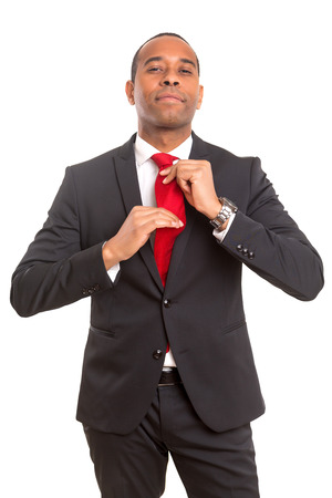 exceptions: African business man fixing his tie, siolated over white Stock Photo