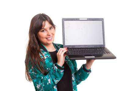 Young woman presenting your product on a laptop computer photo