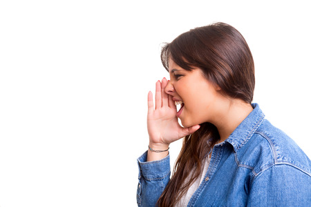 Very happy woman screaming at someone, isolated over a white background photo