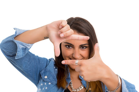 Young woman making framing key gesture - isolated over white photo