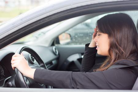 Woman in panic after having a car crash Stock Photo