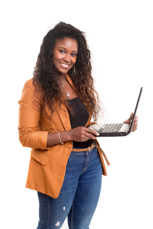 Young african student working with her laptop, isolated over a white background photo