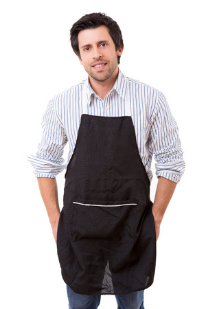 Portrait of handsome young man with apron against white background photo