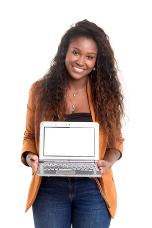 Young african woman presenting your product on a laptop computer photo